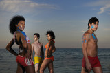 Multiracial group on the beach poster