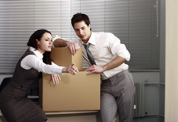Business people in office with boxes