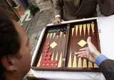 Closeup of two businessmen playing backgammon