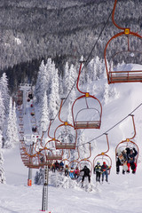 Skiers riding the ski-lift on Jahorina mountain, near Sarajevo,
