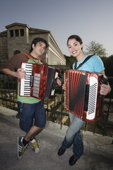Couple at archaeological site playing accordion
