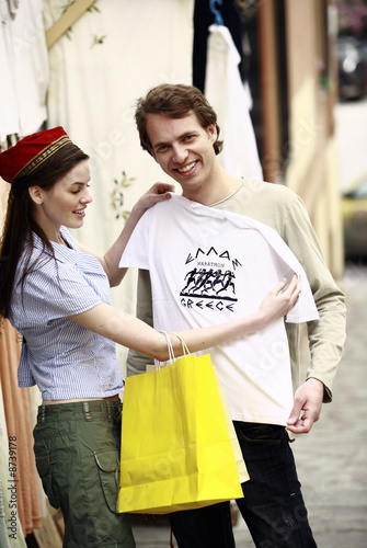 Couple shopping for a Greece tee shirt