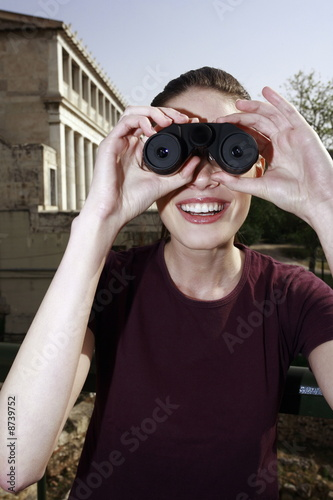 Woman with binoculars at archaeological site