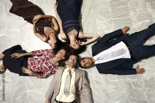 Business people lying on the ground