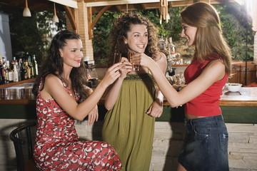 Three women in a bar