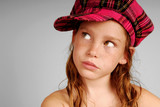 Young girl in plaid cap poster