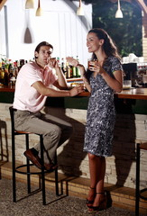 Couple in a bar;man smoking cigar