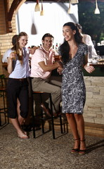 Two women and man in a bar