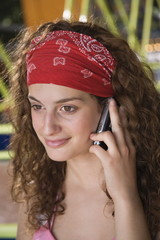 Closeup of female teenager with cell phone