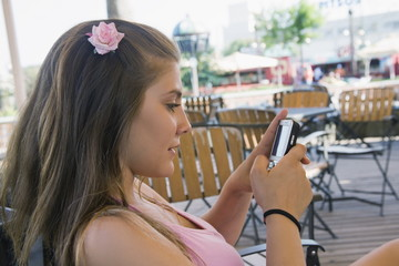 Female teenager on cell phone