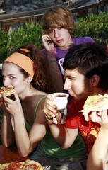 Teenagers hanging out;eating