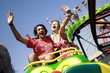 Teenage couple on amusement park ride