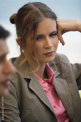 Woman leaning into her hand at a meeting