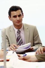Closeup of businessman at meeting