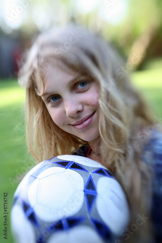 Girl posing with ball