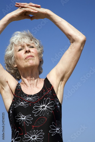 Female senior stretching