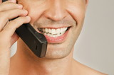 Young male adult mouth talking on cell phone