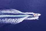 fast motor boat with splash and wake poster