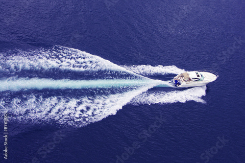 Fotobehang Water Motorsp. fast motor boat with splash and wake