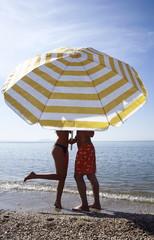 Couple on the beach under umbrella