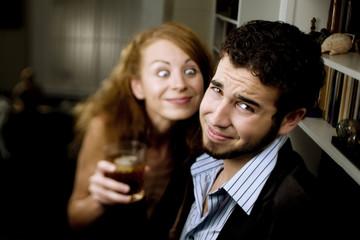 Woman Leers at Man at Party
