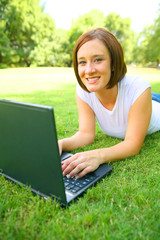 Caucasian Woman Using Laptop Outdoor