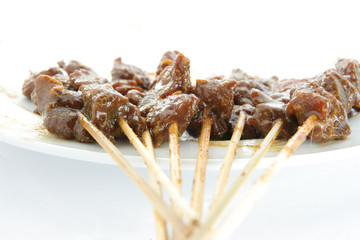 Satay or sate, dice-sized meat on bamboo skewers