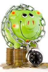 Locked piggy bank on coins