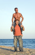 Happy gay couple on beach.