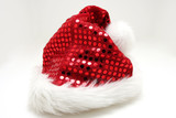 Santas hat on white, red glittering shingles on hat poster