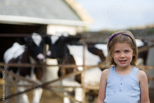 Young Child with Baby Cows