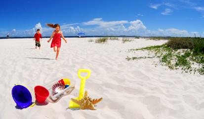 Children Running Towards Beach toys