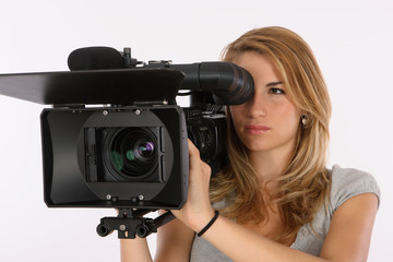 Beautiful Blond Girl Using A Professional Video Camera