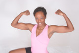 Pretty African American woman flexing her muscles poster
