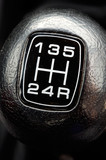 photo of a gear stick of a car - a over black background -