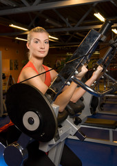 Beautiful woman works out in a gym