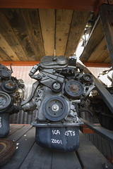 Car engines in junkyard