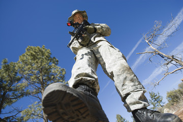Low angle portrait of armed soldier