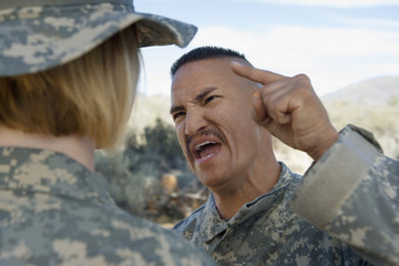 Commander yelling at female soldier