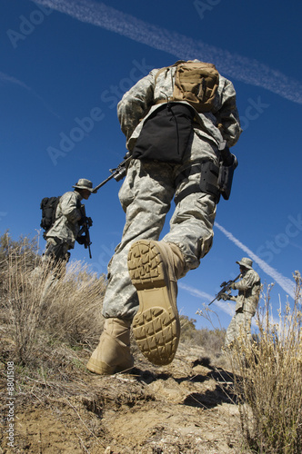 Soldiers walking in field