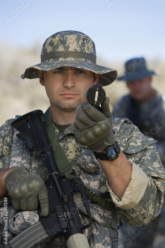 Soldier using compass