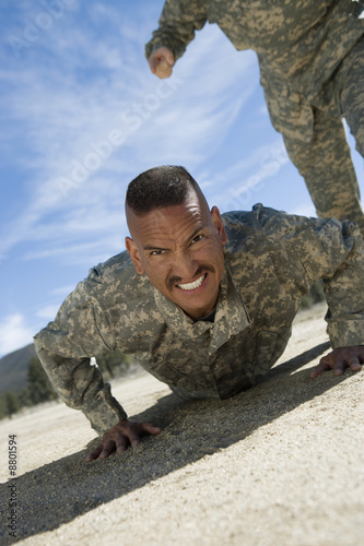 Portrait of soldier doing pushups