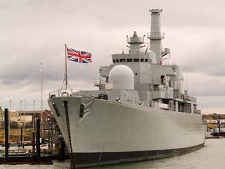 British war ship tied alongside.