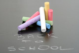 close-ups of blackboard and colorful chalks poster