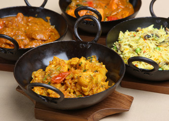 Indian curries in authentic black steel korai dishes