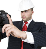 male shooting with camera on isolated background.
