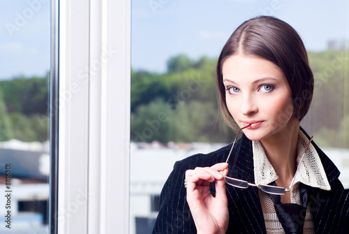 A young good looking businesswoman in glasses potrait