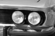 two headlight in black and white american vintage car