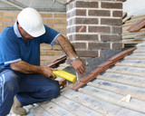Close-up of trainee roofer on mock building site poster