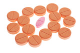 Red pill among orange favored lozenges on white background poster